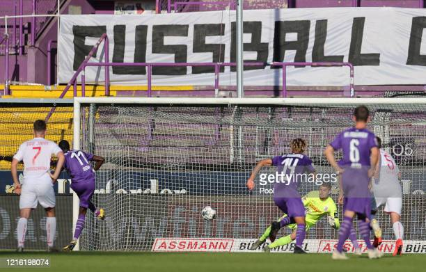 Alexander Meyer of Regensburg saves a penalty taken by Assan Ceesay of Osnabruck during the Second Bundesliga match between VfL Osnabrück and SSV...
