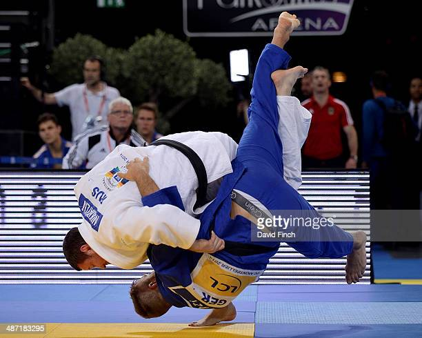 Alexander Mikhaylin of Russia throws KarlRichard Frey of Germany for ippon to put Russia in the Men's team final against Georgia during the...