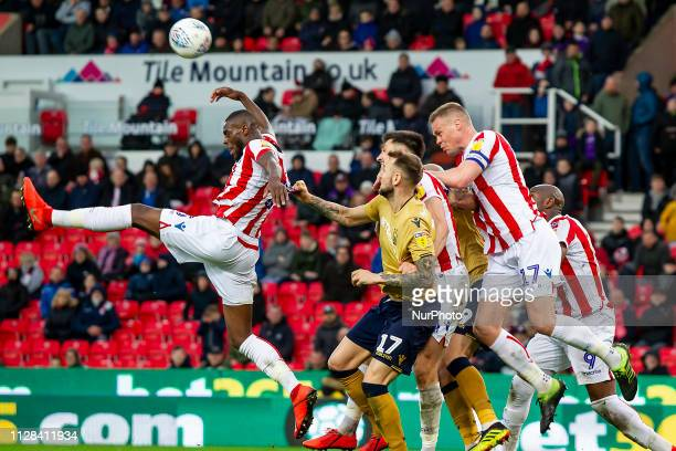 Alexander Milosevic holds on to Bruno Martins of Stoke City during the Sky Bet Championship match between Stoke City and Nottingham Forest at the...