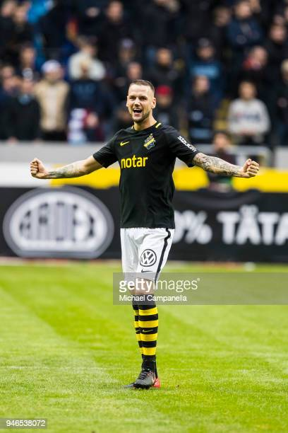 Alexander Milosevic of AIK celebrates AIK's 20 victory after the final whistle is blown during an Allsvenskan match between AIK and Djurgardens IF at...