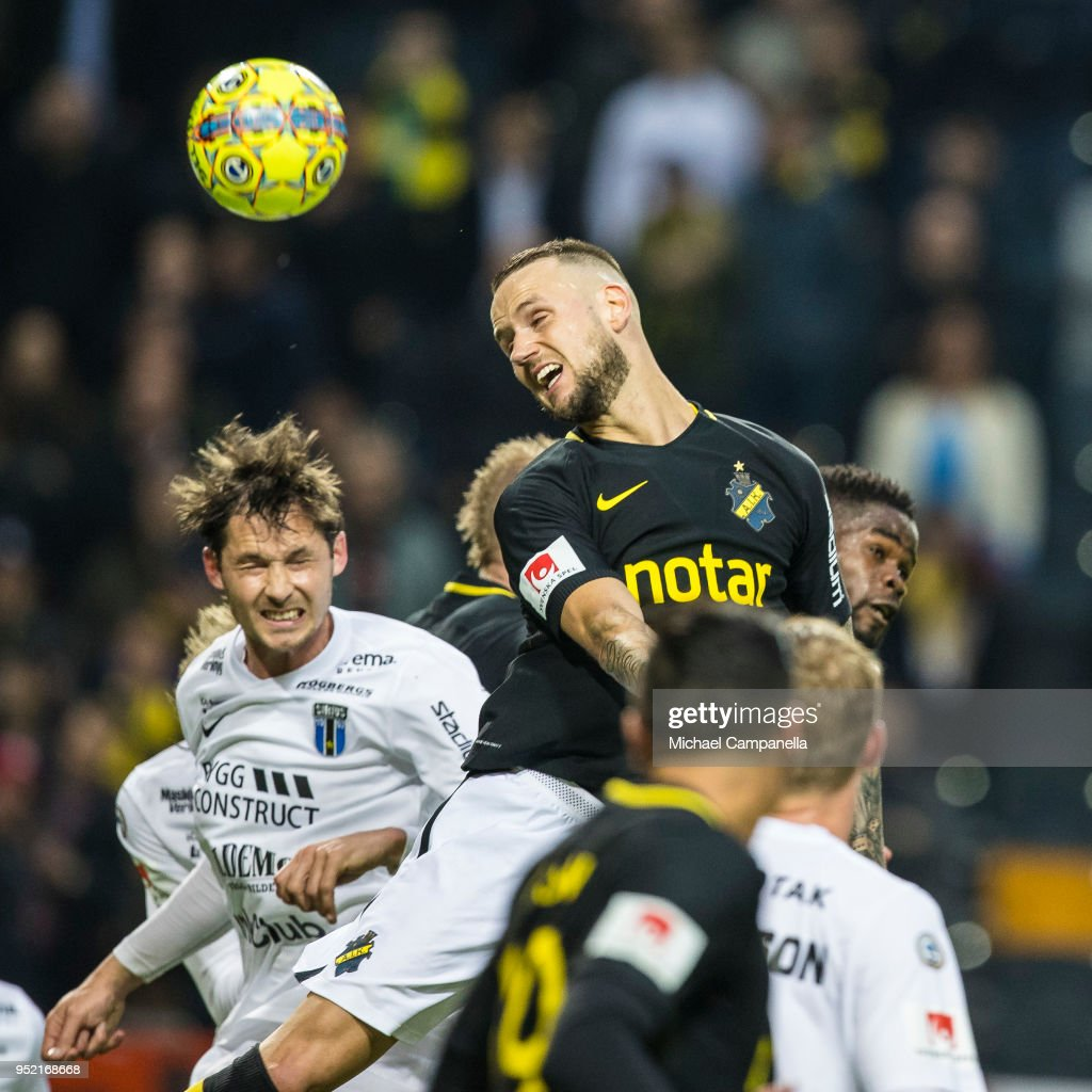 Alexander Milosevic of AIK heads the ball on goal during an Allsvenskan match between AIK and IK Sirius at Friends Arena on April 27, 2018 in Solna, Sweden.
