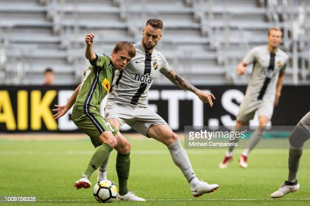 Alexander Milosevic of AIK in a duel with Mikkel Rygaard Jensen of FC Nordsjaelland during a UEFA Europa League second qualifying round match between...
