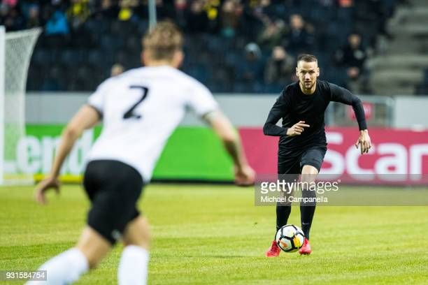 Alexander Milosevic of AIK runs with the ball during a Swedish Cup quarter final match between AIK and Orebro SK at Friends arena on March 13 2018 in...