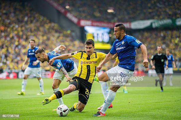 Alexander Milosevic of Darmstadt Sokratis Papastathopoulos of Dortmund and Aenis BenHatira of Darmstadt in action during the Bundesliga match between...
