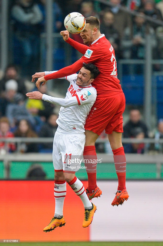 Alexander Milosevic of Hannover is challenged by Leonardo Bittencourt of Koeln during the Bundesliga match between Hannover 96 and 1. FC Koeln at HDI-Arena on March 12, 2016 in Hanover, Germany.