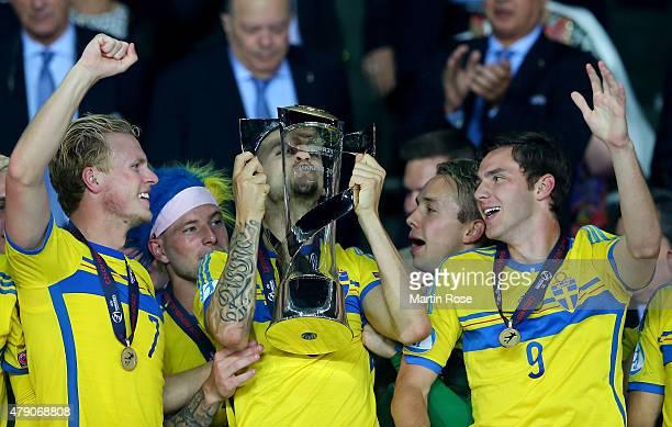 Alexander Milosevic of Sweden lifts the trophy after winning the UEFA European Under21 final match between Sweden and Portugal at Eden Stadium on...