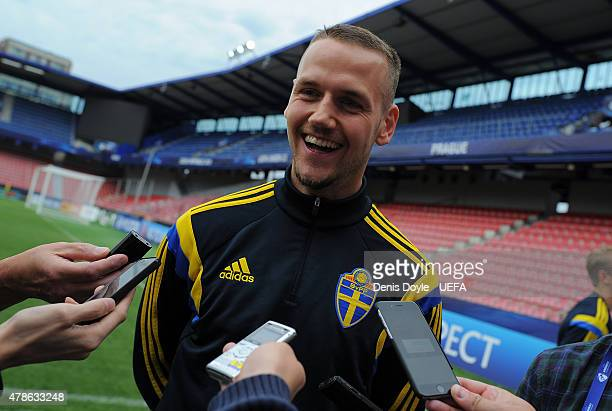 Alexander Milosevic of Sweden talks to members of the press during the UEFA training session ahead of the UEFA European Championships semifinal match...