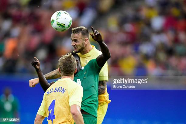 Alexander Milosevic player of Sweden competes for the ball with Oghenekaro Etebo player of Nigeria during 2016 Summer Olympics match between Sweden...