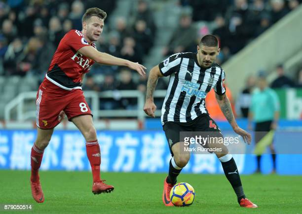 Alexander Mitrovic of Newcastle United is challenged by Tom Cleverly of Watford during the Premier League match between Newcastle United and Watford...