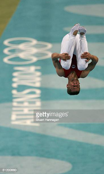 Alexander Moskalenko of Russia competes in the men's trampoline final on August 21, 2004 during the Athens 2004 Summer Olympic Games at the Olympic...