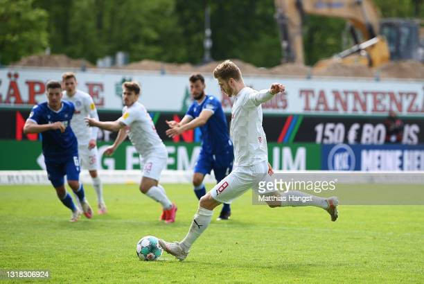 Alexander Muhling of Holstein Kiel scores their team's second goal from the penalty spot during the Second Bundesliga match between Karlsruher SC and...