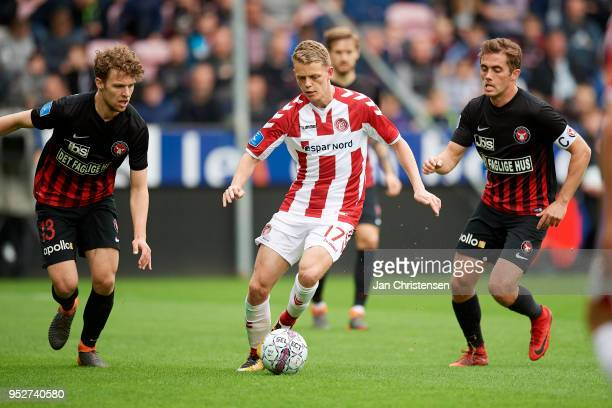 Alexander Munksgaard of FC Midtjylland Kasper Kusk of AaB Aalborg and Jakob Poulsen of FC Midtjylland compete for the ball during the Danish Alka...