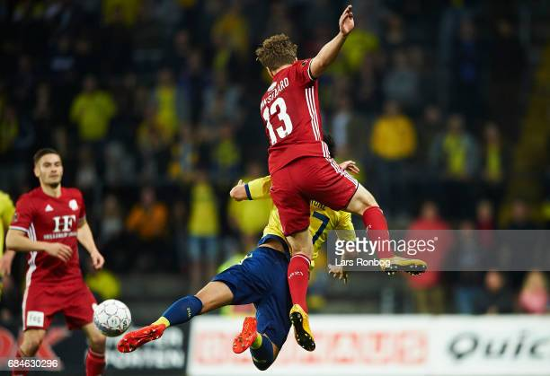Alexander Munksgaard of Lyngby BK and Svenn Crone of Brondby IF compete for the ball during the Danish Alka Superliga match between Brondby IF and...