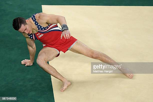 Alexander Naddour of the United States falls while competing on the floor during the men's team final on Day 3 of the Rio 2016 Olympic Games at the...