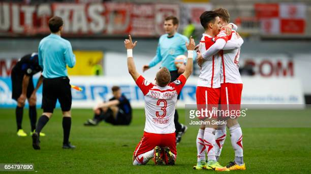 Alexander Nandzik Erik Thommy and Kolja Pusch of Regensburg celebration after the third league match between SC Paderborn and Jahn Regensburg at...