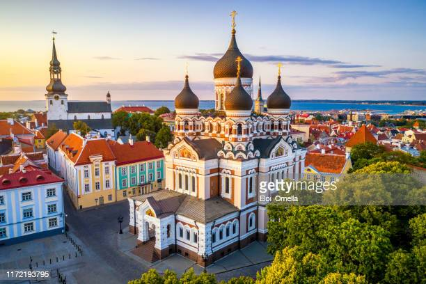 alexander nevsky cathedral and st mary's cathedral at sunset in tallinn, estonia - estonia stock pictures, royalty-free photos & images