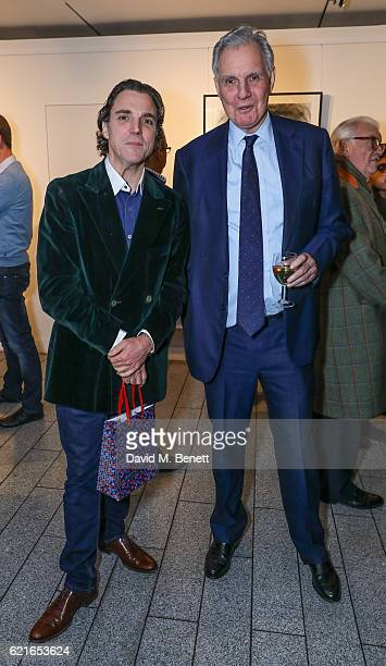 Alexander Newley and Jonathan Aitken attend a private view of artist Alexander Newley's exhibition 'Portraits In Character' at St MartinintheFields...