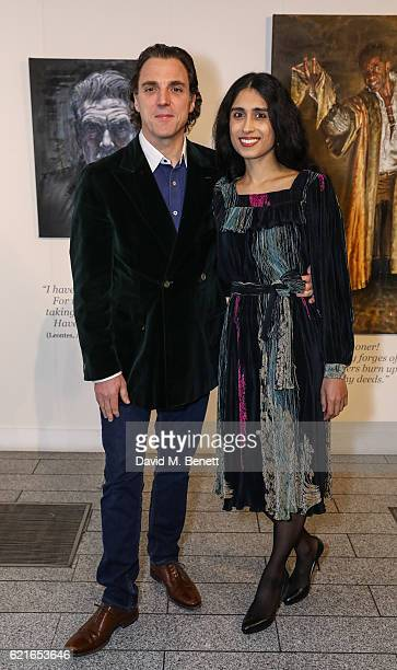 Alexander Newley and Sheila Raman attend a private view of artist Alexander Newley's exhibition 'Portraits In Character' at St MartinintheFields on...