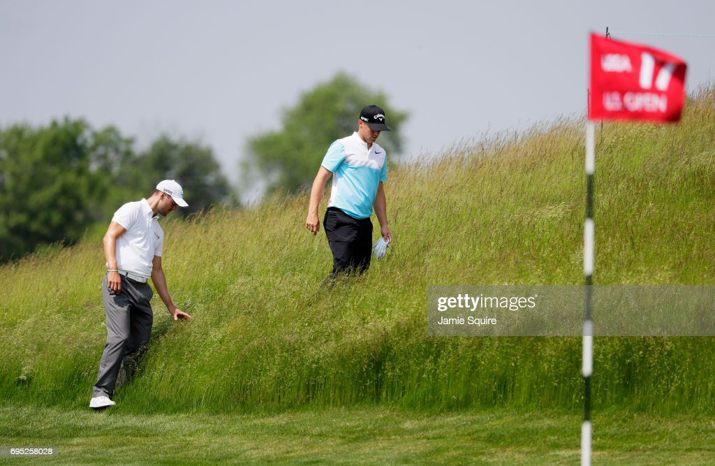Alexander Noren of Sweden and Martin Kaymer of Germany look for a ball on the 17th hole during a practice round prior to the 2017 U.S. Open at Erin Hills on June 12, 2017 in Hartford, Wisconsin.