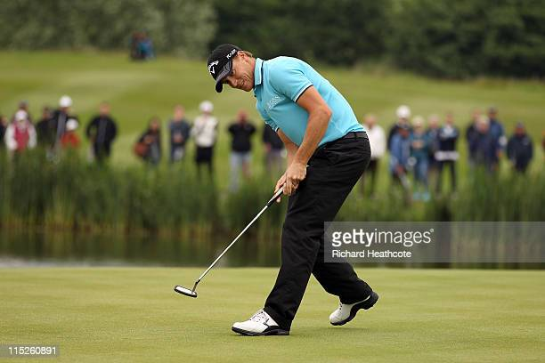 Alexander Noren of Sweden celebrates as he holes a birdie putt on the 12th green during the final round of the Saab Wales Open on the Twenty Ten...