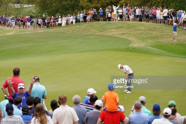 Alexander Noren of Sweden lines up a putts on the 16th green during a playoff for his semifinal round match against Kevin Kisner of the United States...