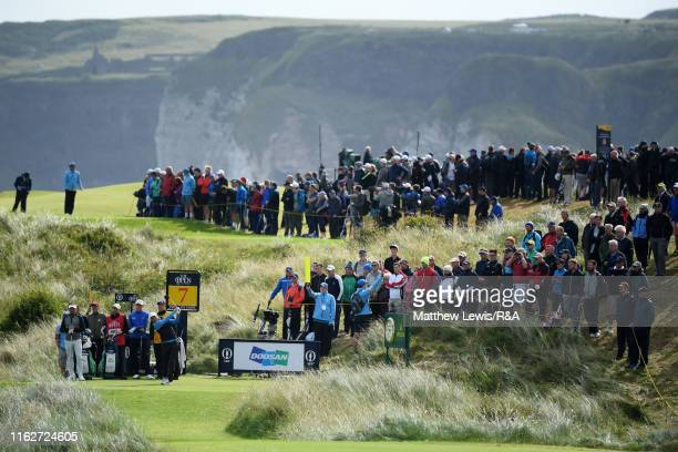 Alexander Noren of Sweden plays his shot from the seventh tee during the first round of the 148th Open Championship held on the Dunluce Links at...