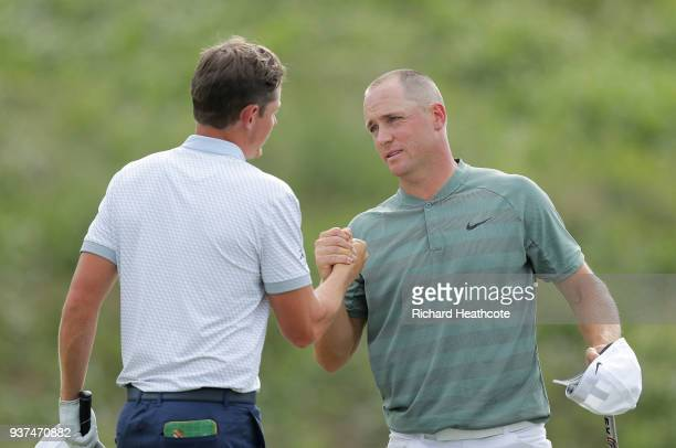 Alexander Noren of Sweden shakes hands with Cameron Smith of Australia after defeating him 42 on the 16th green during the quarterfinal round of the...