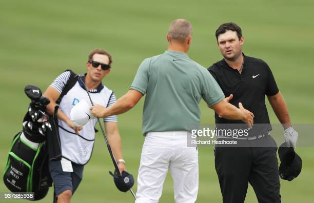 Alexander Noren of Sweden shakes hands with Patrick Reed of the United States after defeating him 53 on the 15th green during the fourth round of the...