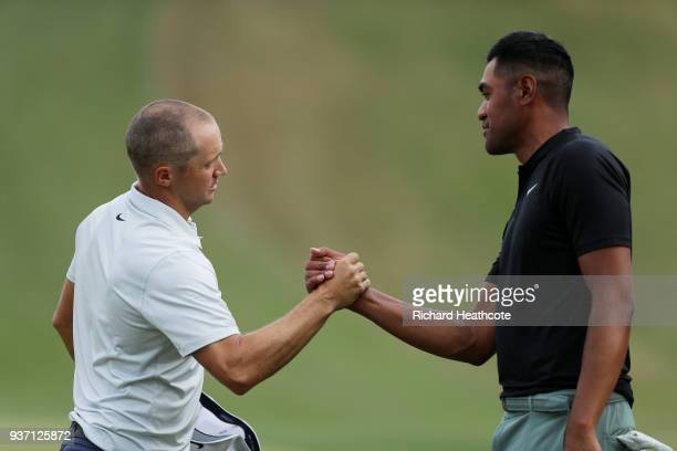 Alexander Noren of Sweden shakes hands with Tony Finau of the United States after defeating him 1up on the 18th green during the third round of the...