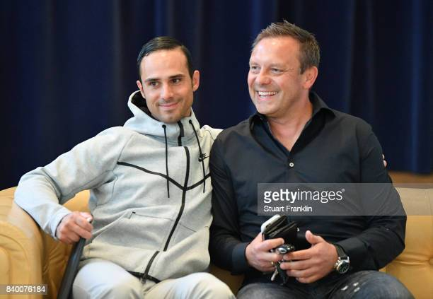 Alexander Nouri head coach of Bremen and Andre Breitenreiter head coach of Hannover look on during the DFB and Bundesliga Coach Forum on August 28...