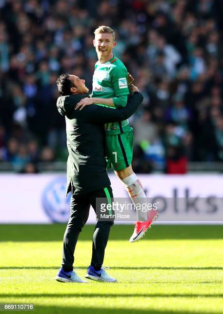 Alexander Nouri, head coach of Bremen celebrate with Florian LKainz after the Bundesliga match between Werder Bremen and Hamburger SV at Weserstadion...
