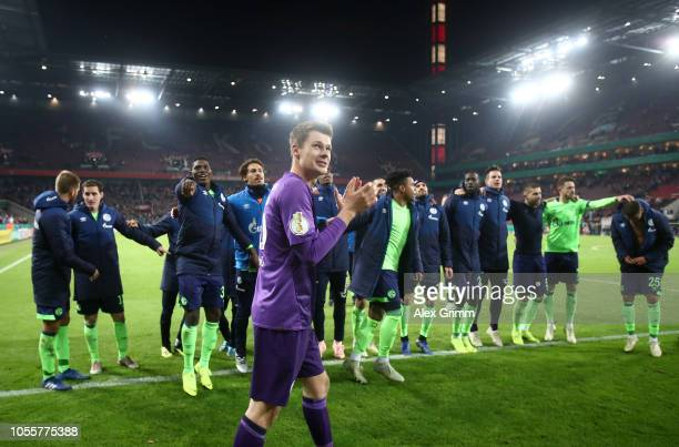 Alexander Nubel of FC Schalke 04 celebrates with his team mates following victory in a penalty shoot out during the DFB Cup match between 1 FC Koeln...