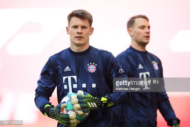 Alexander Nuebel of FC Bayern Muenchen and Manuel Neuer of FC Bayern Muenchen looks on during the Bundesliga match between FC Bayern Muenchen and 1....