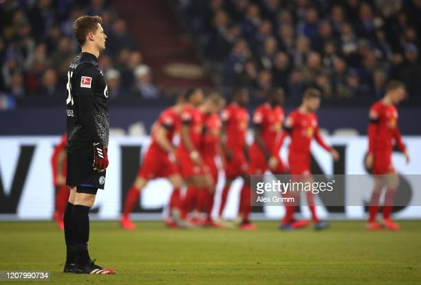 Alexander Nuebel of FC Schalke 04 reacts after Leipzig score their first goal during the Bundesliga match between FC Schalke 04 and RB Leipzig at...