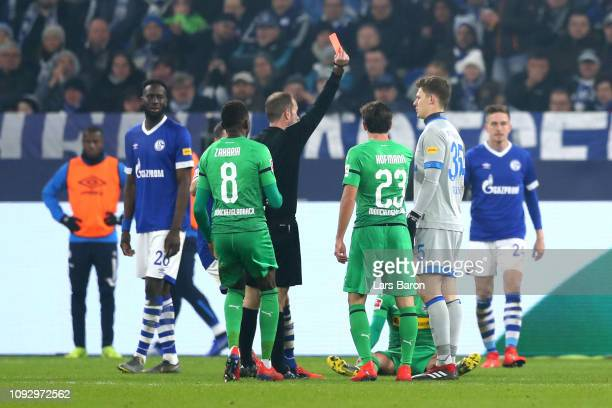 Alexander Nueebel of FC Schalke 04 is shown a red card by referee Alexander Nubel during the Bundesliga match between FC Schalke 04 and Borussia...