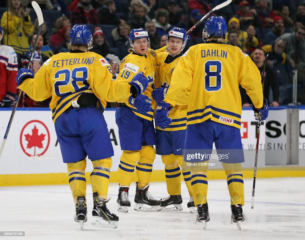 Alexander Nylander #19 of Sweden celebrates with teammates after scoring a goal in the third period against Czech Republic during the IIHF World Junior Championship at KeyBank Center on December 28, 2017 in Buffalo, New York. Sweden beat Czech Republic 3-1.