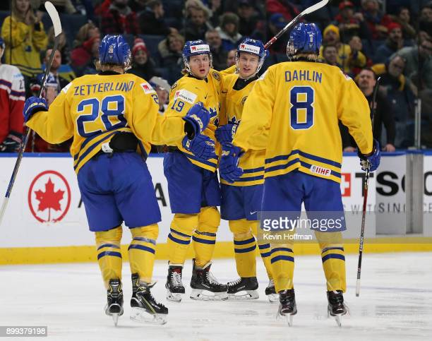 Alexander Nylander of Sweden celebrates with teammates after scoring a goal in the third period against Czech Republic during the IIHF World Junior...