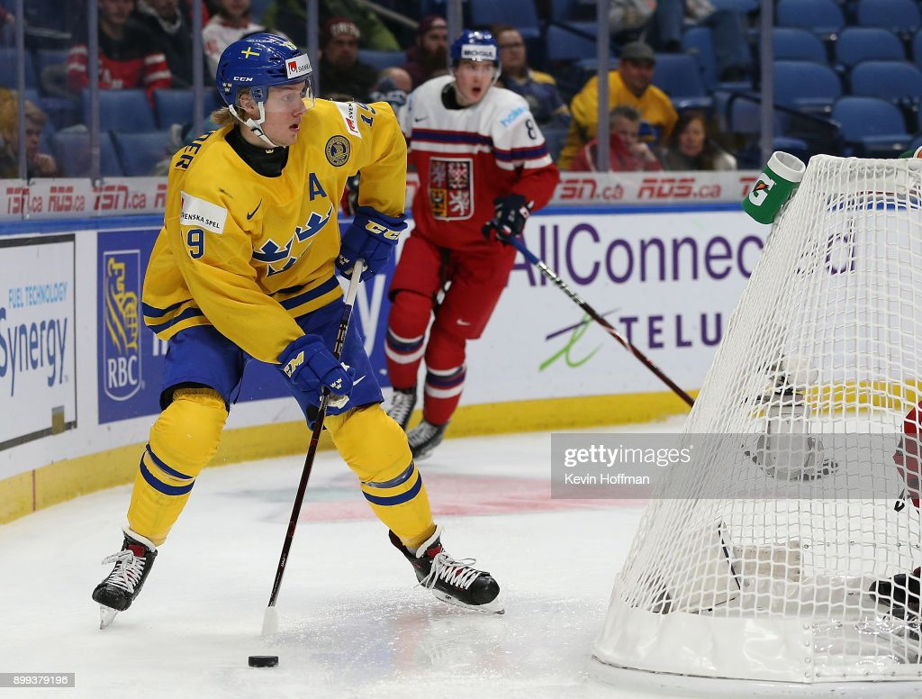 Alexander Nylander #19 of Sweden with the puck behind the Czech Republic net in the third period during the IIHF World Junior Championship at KeyBank Center on December 28, 2017 in Buffalo, New York. Sweden beat Czech Republic 3-1.