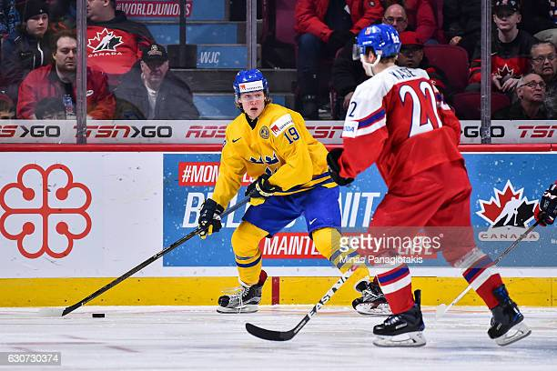 Alexander Nylander of Team Sweden looks to play the puck during the 2017 IIHF World Junior Championship preliminary round game against Team Czech...