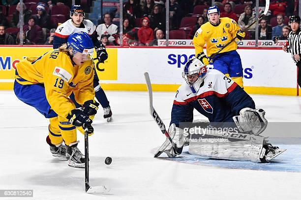 Alexander Nylander of Team Sweden tries to capitalize on a rebound near goaltender Adam Huska of Team Slovakia during the 2017 IIHF World Junior...