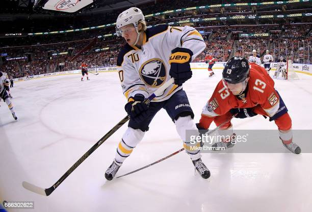 Alexander Nylander of the Buffalo Sabres and Mark Pysyk of the Florida Panthers fight for the puck during a game at BBT Center on April 8 2017 in...
