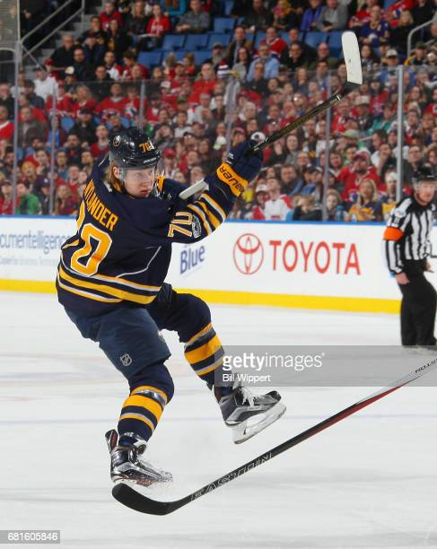 Alexander Nylander of the Buffalo Sabres follows through on a shot against the Montreal Canadiens during an NHL game at KeyBank Center on April 5...