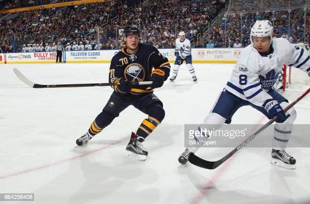 Alexander Nylander of the Buffalo Sabres playing in his first NHL game skates against Connor Carrick of the Toronto Maple Leafs at the KeyBank Center...