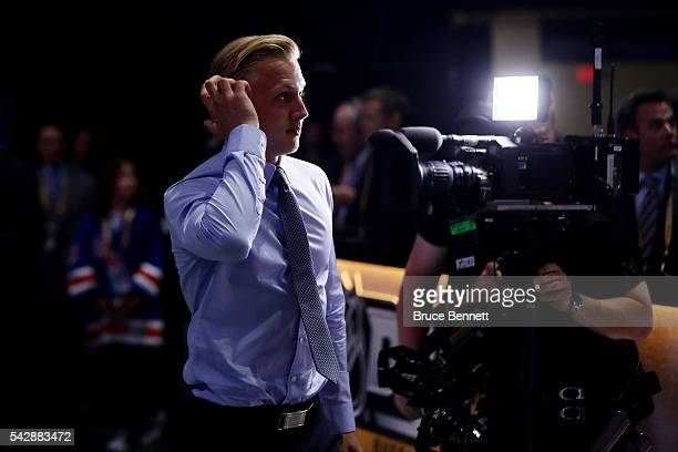 Alexander Nylander reacts after being selected eighth overall by the Buffalo Sabres during round one of the 2016 NHL Draft on June 24 2016 in Buffalo...