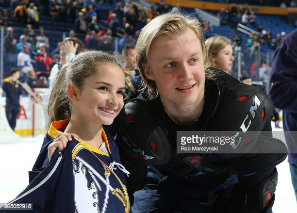 Alexander Nylander right of the Buffalo Sabres gives his jersey to a fan following their 21 victory against the Montreal Canadiens in an NHL game at...