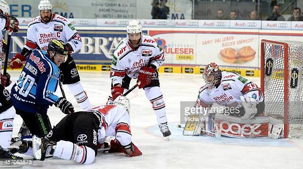 Alexander Oblinger of Ingolstadt and Torsten Ankert battle for the puck in front of Danny aus den Birken's goal in game six of the DEL final playoffs...