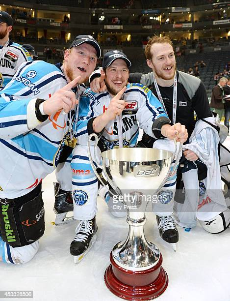 Alexander Oblinger , Patrick Hager and Benedikt Schopper celebrate the championship with the trophy after game seven of the DEL playoff final on...