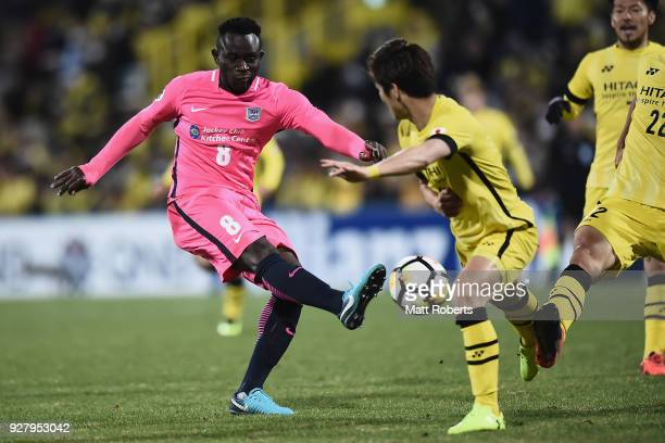 Alexander Oluwatayo of Kitchee SC kicks under pressure during the AFC Champions League Group E match between Kashiwa Reysol and Kitchee at Sankyo...