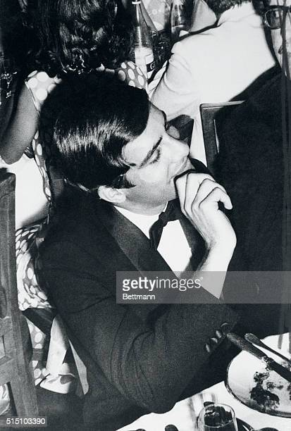 Alexander Onassis son of Aristotle Onassis is shown seemingly bored at the Pierre Cardin fashion show