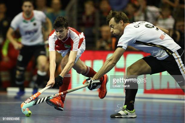 Alexander Otte of Germany and Ferdinand Weinke of Austria compete for the ball during the Mens Gold Medal Indoor Hockey World Cup Berlin Final Day...